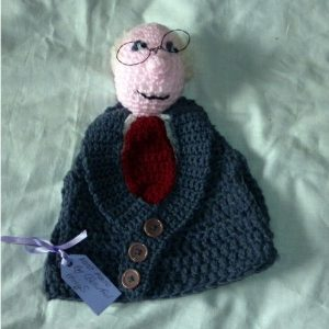 Hand crochet tea-cosie of Michael D Higgins .