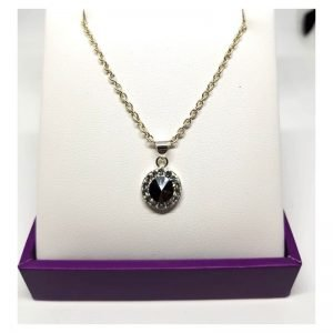 Sterling silver pendant - black center stone